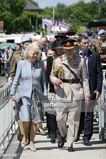 Britain's Prince Charles and the Duchess of Cornwall Camilla arrive during a DDay commemoration event at the Pegasus bridge in Benouville northern...
