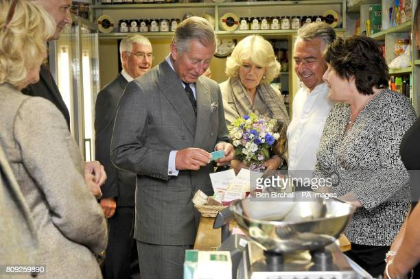 Britain's Prince Charles and the Duchess of Cornwall examine unisex handmade soaps in the shop annex at the White Horse pub in Blandford Forum Dorset