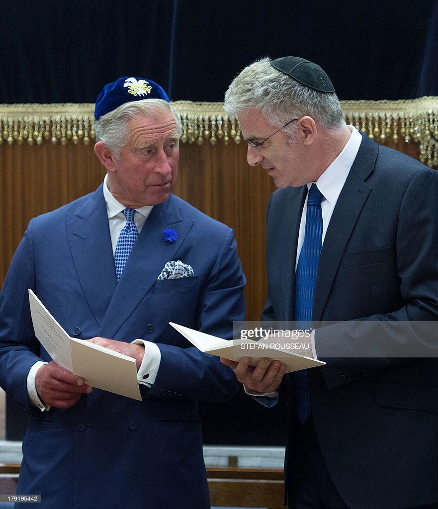 Britain's Prince Charles (L) and the Israeli Ambassador Daniel Taub join Rabbis and members of the Orthodox Jewish community as they attend the Installation of Chief Rabbi Ephraim Mirvis as the 11th Chief Rabbi of the United Hebrew Congregations of the UK and the Commonwealth during a ceremony at the St John's Wood Synagogue in north London on Spetember 1, 2013. AFP Photo / POOL / STEFAN ROUSSEAU