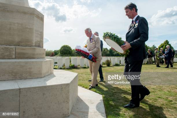 Britain's Prince Charles and Vice Admiral Sir Timothy Laurence lay a wreath during a ceremony at the Artillery Wood Cemetery in Ypres on July 31 as...