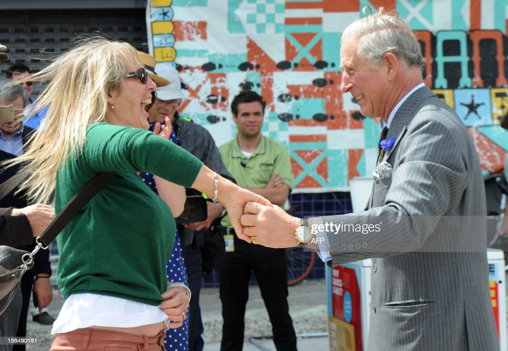 Britain's Prince Charles (R) dances with Lisa Shannon during a rock n roll dance display in Christchurch on November 16, 2012. Britain's Prince Charles and his wife Camilla are on the last leg of a tour to mark Queen Elizabeth II's diamond jubilee which has also included Papua New Guinea and Australia and ends on November 16. AFP PHOTO / POOL / Ross Setford