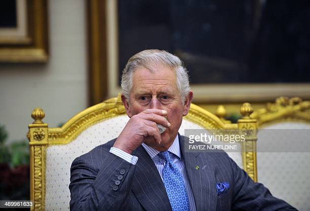 Britain's Prince Charles drinks coffee during a meeting with Saudi National Guard Minister Mutaib bin Abdullah bin Abdulaziz on February 17 2014 in...