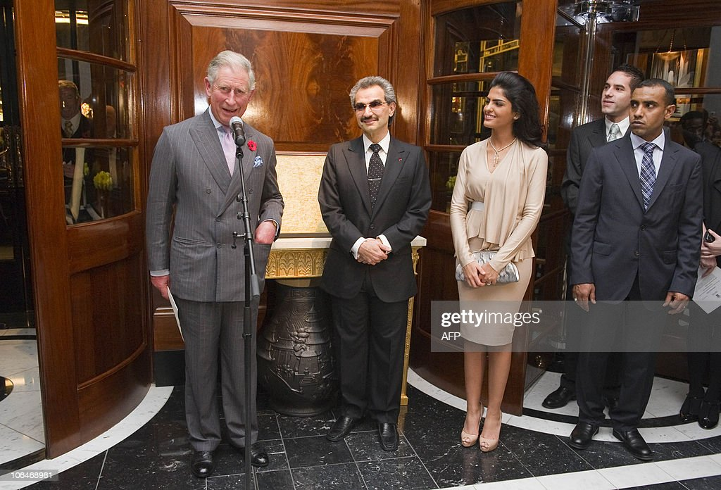 Britain�s Prince Charles (1st L), flanked by Saudi Prince Alwaleed Bin Talal (2nd L), his wife Amira (3rd L) delivers a speech during a tour at the official re-opening of the Savoy Hotel in London, on November 2, 2010. London's first luxury hotel, which hosted luminairies from Marlene Dietrich to Claude Monet, has been renovated from top to bottom in a mammoth project costing 220 million pounds (250 million euros, 350 million dollars).