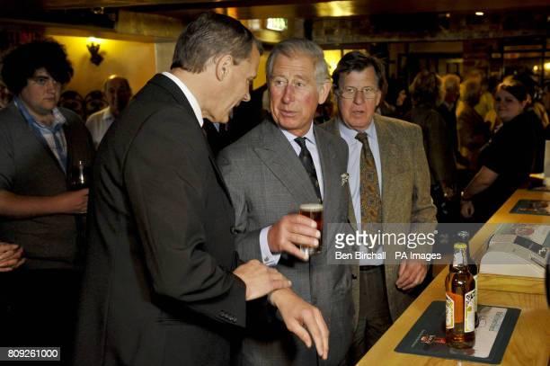 Britain's Prince Charles has half a pint of Firkin Fox at the White Horse pub in Blandford Forum Dorset