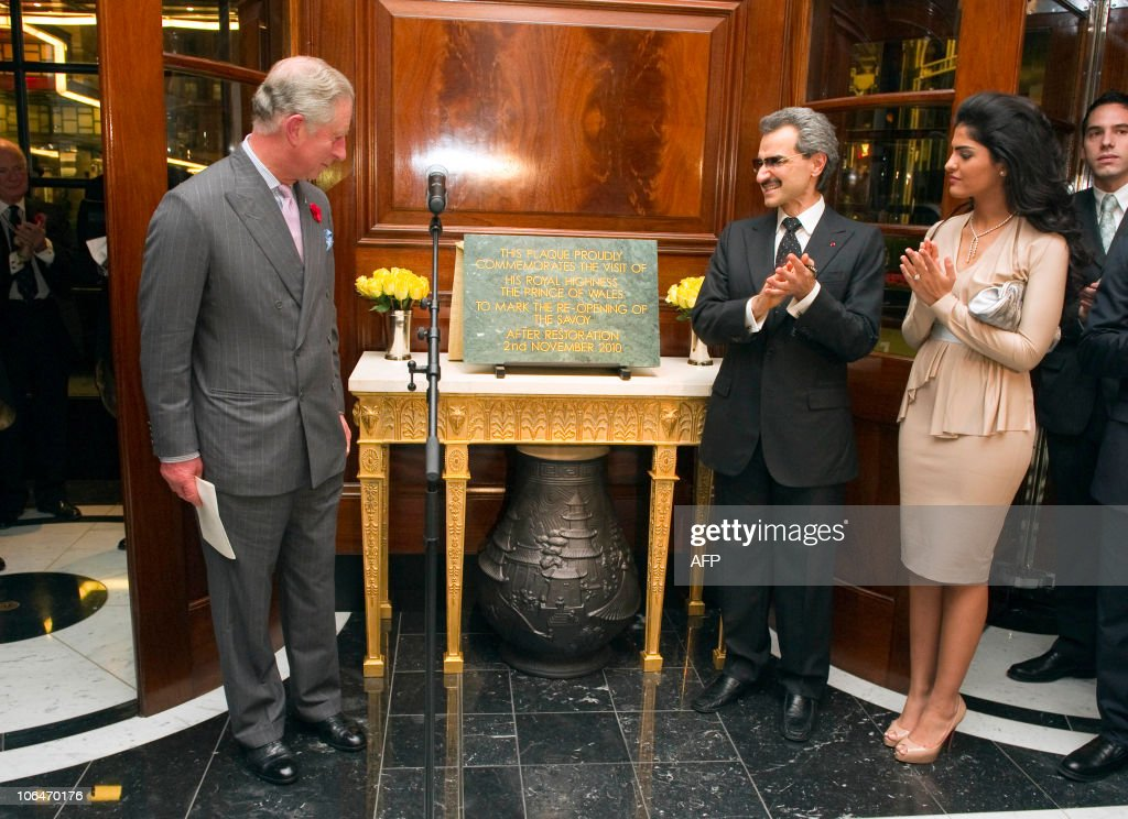 Britain�s Prince Charles (L) is applauded by Prince Alwaleed Bin Talal Bin Abdulaziz Alsaud (C) and his wife Princess Amira after he unveiled a plaque during the official re-opening of the Savoy Hotel in London on November 2, 2010. London's first luxury hotel, which hosted luminairies from Marlene Dietrich to Claude Monet, has been renovated from top to bottom in a mammoth project costing 220 million pounds (250 million euros, 350 million dollars).