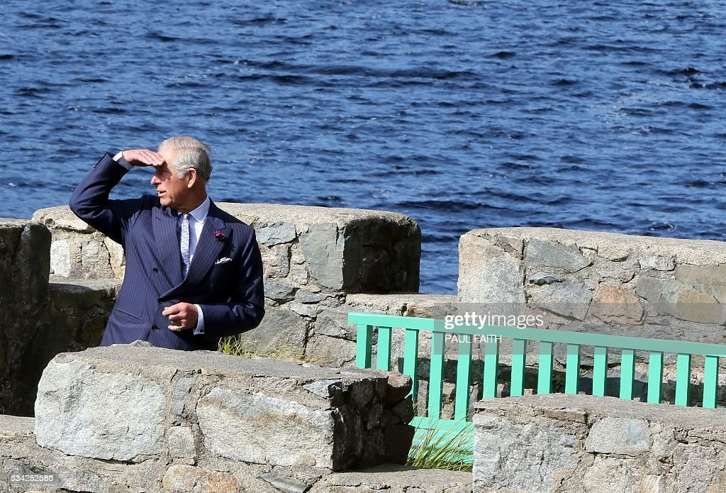 Britain's Prince Charles is pictured during a tour of the boat house at Glenvagh National Park in Donegal, Ireland, on May 25, 2016. / AFP / PAUL