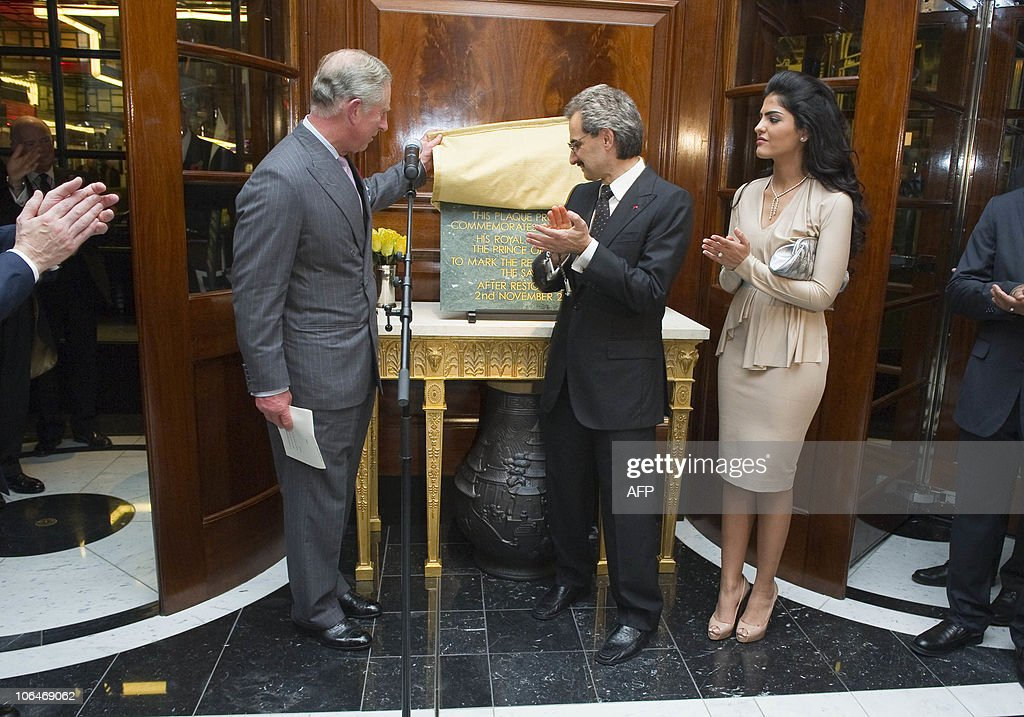 Britain�s Prince Charles (left) is watched by Prince Alwaleed Bin Talal Bin Abdulaziz Alsaud (C) and wife Princess Amira after he unveiled a plaque during a tour at the official re-opening of the Savoy Hotel in London, on November 2, 2010. London's first luxury hotel, which hosted luminairies from Marlene Dietrich to Claude Monet, has been renovated from top to bottom in a mammoth project costing 220 million pounds (250 million euros, 350 million dollars).