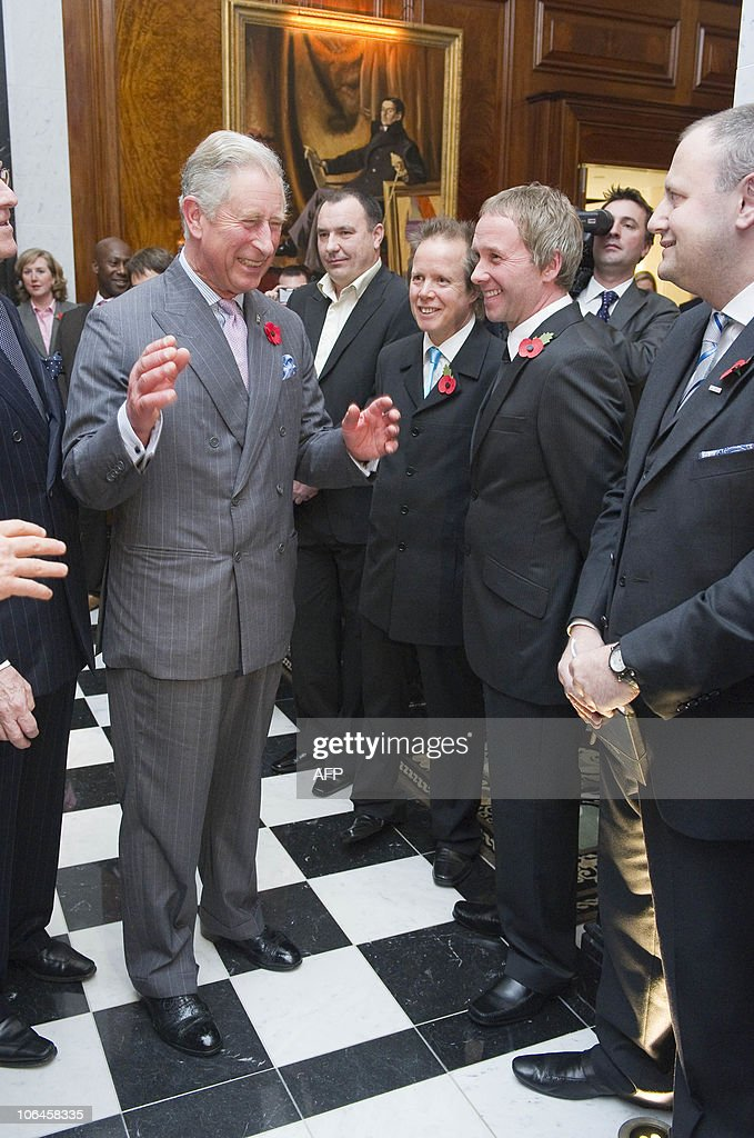 Britain�s Prince Charles (L) jokes with John (C) and Robert (R) Bishop, who polished wood for two years in the restoration during a tour at the official re-opening of the Savoy Hotel in London, on November 2, 2010. London's first luxury hotel, which hosted luminairies from Marlene Dietrich to Claude Monet, has been renovated from top to bottom in a mammoth project costing 220 million pounds (250 million euros, 350 million dollars).