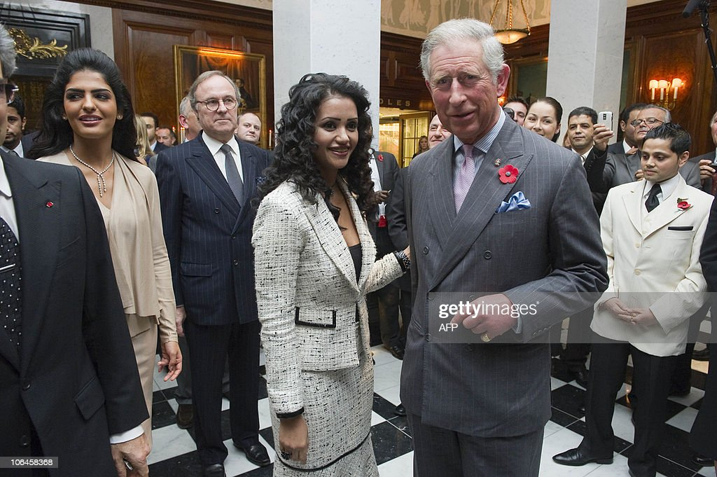 Britain�s Prince Charles (R) meets Amani Al Qhtani, the executive assistant to HRH Royal Palace Saudi during a tour at the official re-opening of the Savoy Hotel in London, on November 2, 2010. London's first luxury hotel, which hosted luminairies from Marlene Dietrich to Claude Monet, has been renovated from top to bottom in a mammoth project costing 220 million pounds (250 million euros, 350 million dollars). AFP PHOTO -POOL- ROLAND HOSKINS -