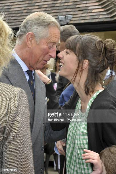 Britain's Prince Charles meets his great nieceinlaw Alice Irwin at the White Horse pub in Blandford Forum Dorset