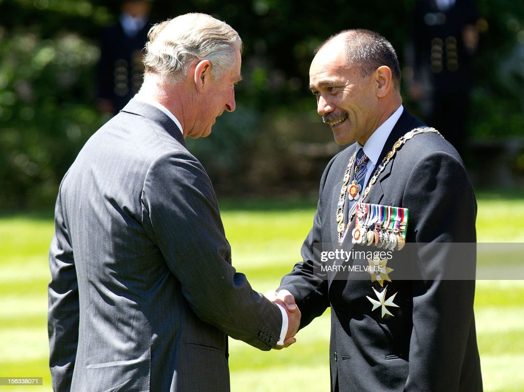 Britain's Prince Charles (L) meets the Governor General of New Zealand Lt General Rt Hon Sir Jerry Mateparae during a welcoming ceremony at Government House in Wellington on November 14, 2012. The Royal couple are in New Zealand on the last leg of a Diamond Jubilee that takes in Papua New Guinea, Australia and New Zealand. AFP PHOTO / Marty Melville