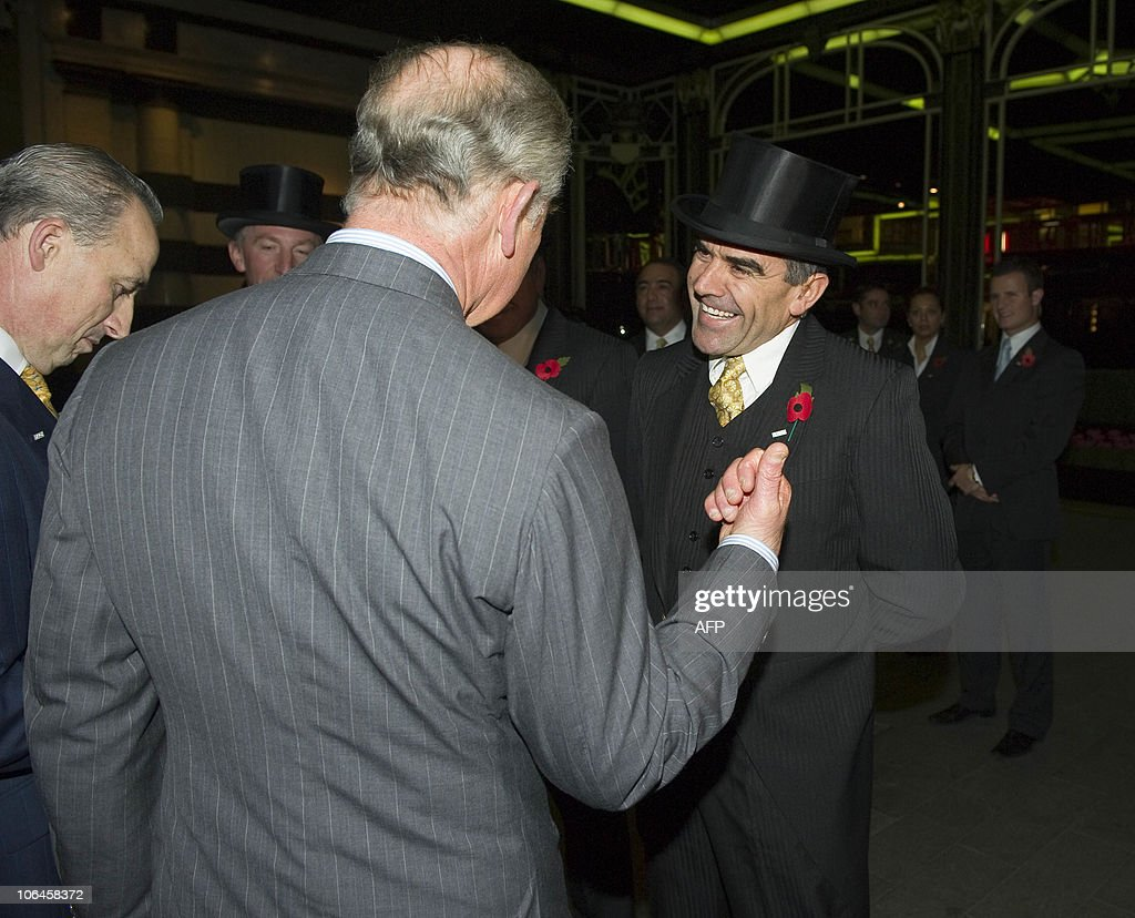 Britain�s Prince Charles (L) meets with the hotel head doorman (R) during a tour at the official re-opening of the Savoy Hotel in London, on November 2, 2010. London's first luxury hotel, which hosted luminairies from Marlene Dietrich to Claude Monet, has been renovated from top to bottom in a mammoth project costing 220 million pounds (250 million euros, 350 million dollars).