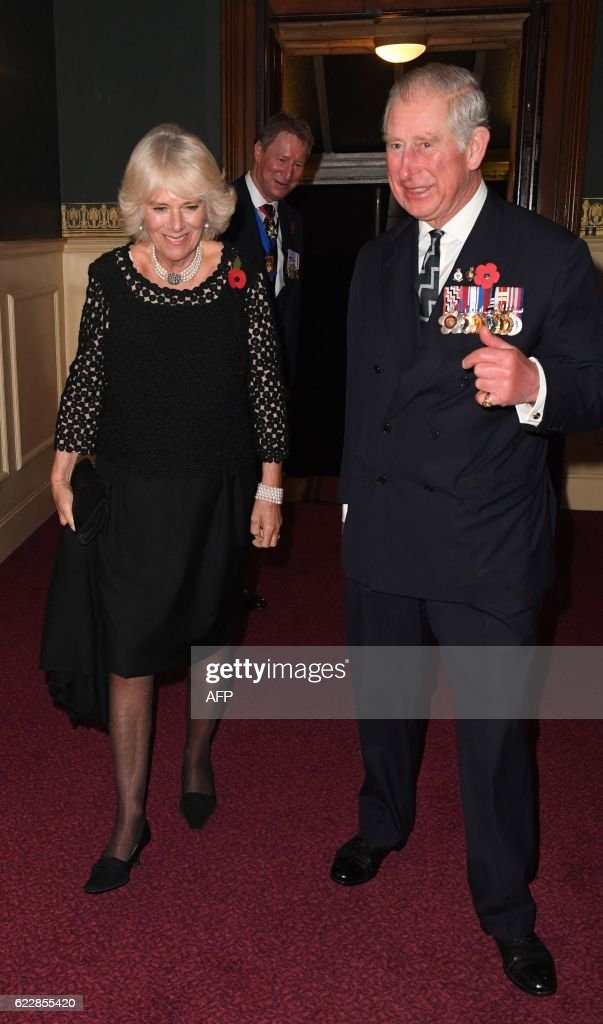 Britain's Prince Charles, Prince of Wales and Britain's Camilla, Duchess of Cornwall (L) arrive at the Royal Albert Hall for the annual Royal Festival of Remembrance in central London on November 12, 2016. This year's Festival will mark the following anniversaries: the centenaries of the Battle of the Somme and the Battle of Jutland, the 25th anniversary of the Gulf War and the and the 80th anniversary of the first flight of the Supermarine Spitfire. / AFP / POOL / Victoria Jones