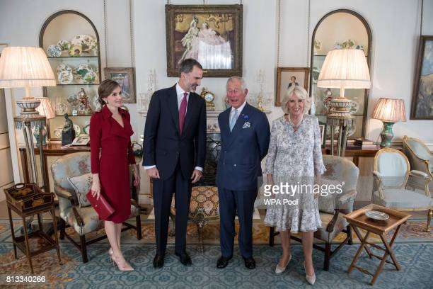 Britain's Prince Charles Prince of Wales and Camilla Duchess of Cornwall greet King Felipe VI of Spain and Queen Letizia of Spain as they visit...