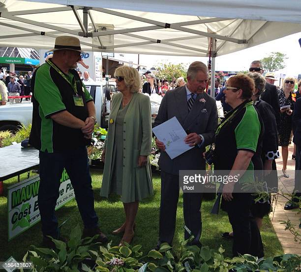 Britain's Prince Charles Prince of Wales and Camilla Duchess of Cornwall meet locals during a farmers market walk about in on November 15 2012 in...