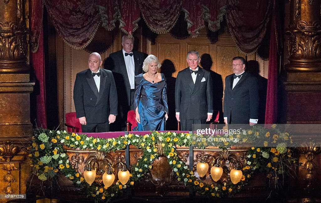 Britain's Prince Charles, Prince of Wales (CR) and Camilla, Duchess of Cornwall (CL) stand in the royal box as they attend the Royal Variety Performance at the London Palladium Theatre on November 25, 2013. The Royal Variety Performance takes place annually in aid of the Entertainment Artistes Benevolent Fund (EABF) which cares for hundreds of entertainers throughout the UK who need help and assistance as a result of old age, ill-health or hard times.