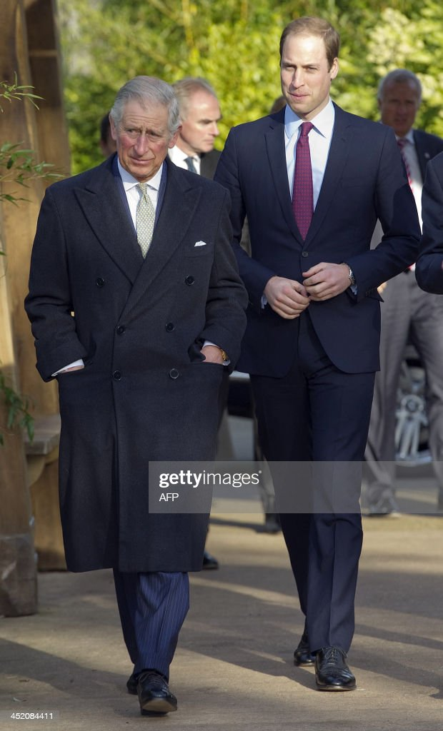 Britain's Prince Charles, Prince of Wales (L), and his son Prince William, Duke of Cambridge, visit the Zoological Society of London to attend a meeting of 'United for Wildlife' collaboration in London on November 26, 2013. Duke of Cambridge is President of United for Wildlife, a collaboration of seven of the largest global conservation organisations.