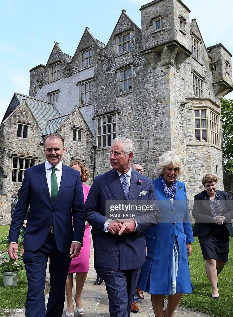 Britain's Prince Charles, Prince of Wales (C) and his wife Britain's Camilla, Duchess of Cornwall (2R), tour Dongal Castle on May 25, 2016. Situated at the centre of Donegal town, Donegal Castle was fully restored in the late 1990s by the Office of Public Works. The castle consists of a 15th-century rectangular Tower House with a later Jacobean style wing known as the Manor House. / AFP / PAUL