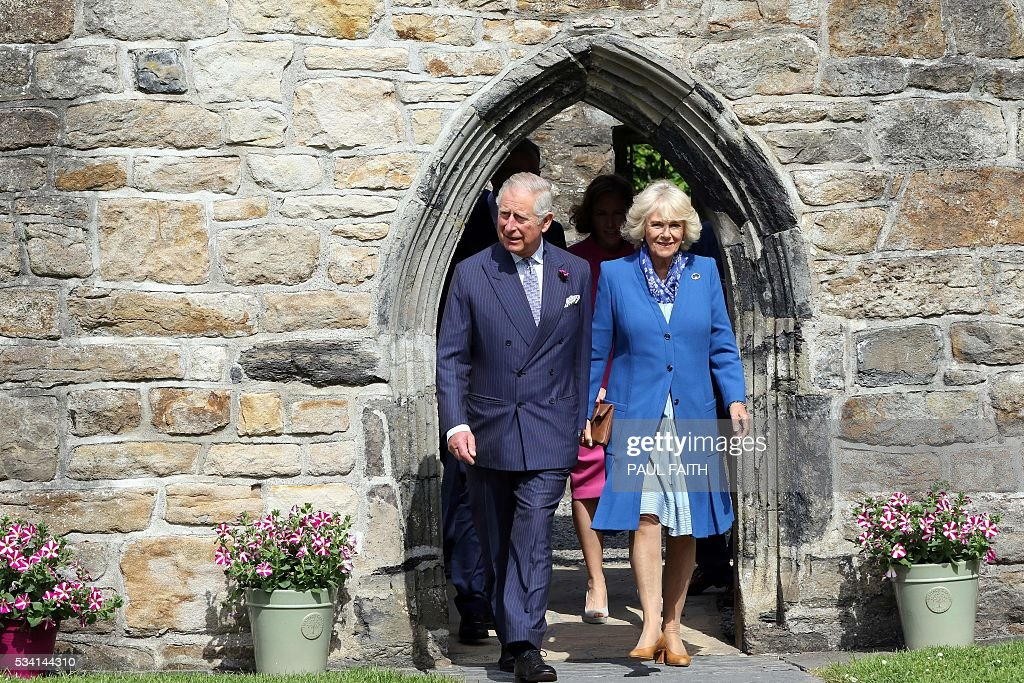 Britain's Prince Charles, Prince of Wales (L) and his wife Britain's Camilla, Duchess of Cornwall, tour Dongal Castle on May 25, 2016. Situated at the centre of Donegal town, Donegal Castle was fully restored in the late 1990s by the Office of Public Works. The castle consists of a 15th-century rectangular Tower House with a later Jacobean style wing known as the Manor House. / AFP / PAUL