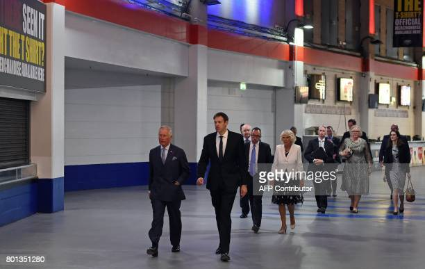 Britain's Prince Charles Prince of Wales and his wife Britain's Camilla Duchess of Cornwall are escorted through Manchester Arena in Manchester north...
