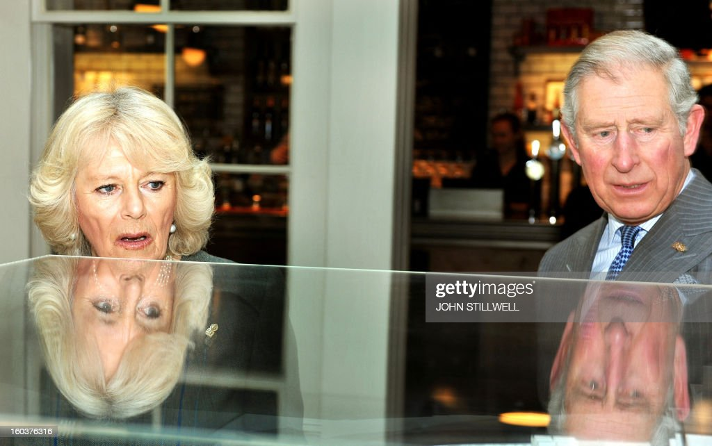 Britain's Prince Charles, Prince of Wales (R), and his wife Camilla, Duchess of Cornwall (L) study a model of the refurbished King's Cross train Station during an event to mark 150 years of the London Underground at Kings Cross in London on January 30, 2013. The London Underground was the world's first underground railway, then known as the Metropolitan Railway, unveiled its first stretch of track between Paddington and Farringdon on January 9, 1863, with passengers making their first journeys a day later.