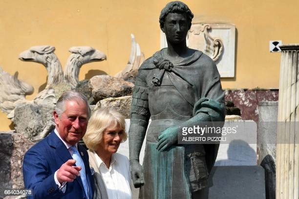 Britain's Prince Charles Prince of Wales and the Duchess of Cornwall Camilla arrive at the 'Opificio delle Pietre Dure' a Florentine art restoration...