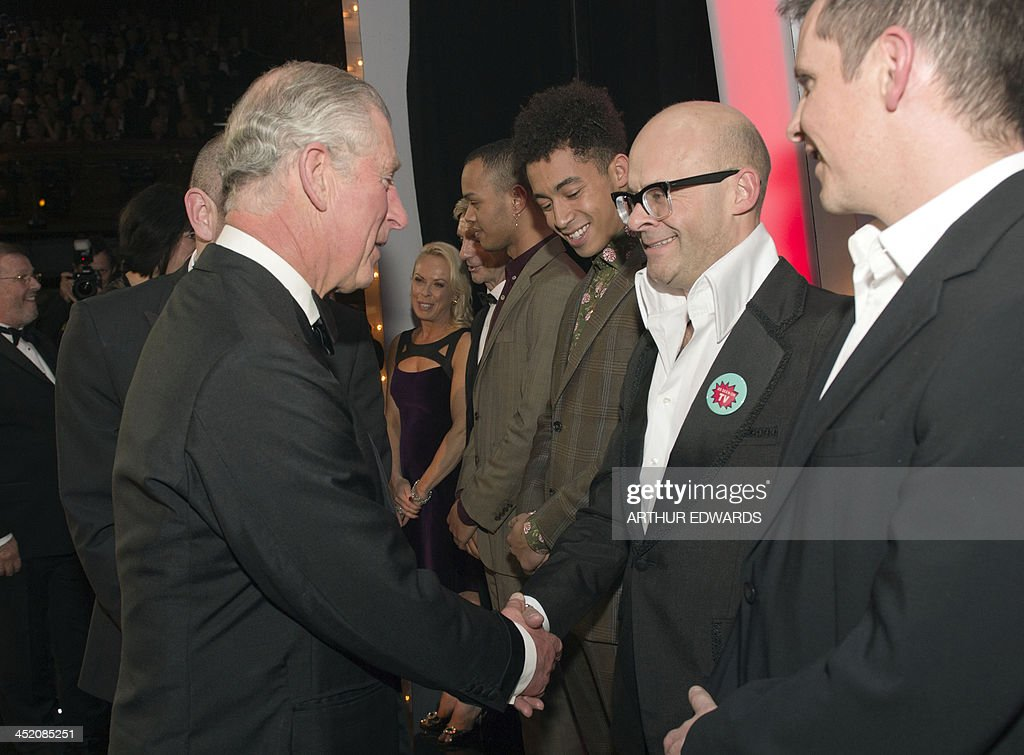 Britain's Prince Charles, Prince of Wales (L) British comedian Harry Hill (R) as he attends the Royal Variety Performance at the London Palladium Theatre on November 25, 2013. The Royal Variety Performance takes place annually in aid of the Entertainment Artistes Benevolent Fund (EABF) which cares for hundreds of entertainers throughout the UK who need help and assistance as a result of old age, ill-health or hard times.