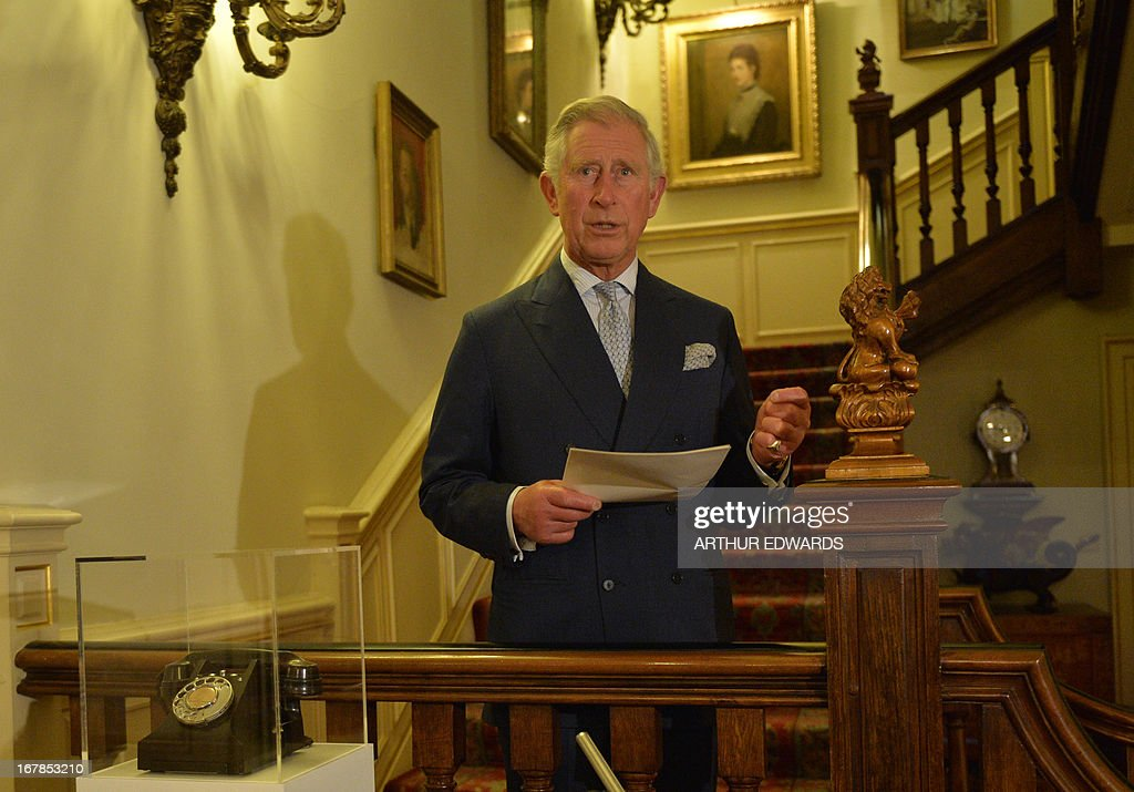Britain's Prince Charles, Prince of Wales, gives a speech next to the first telephone used by founder Chad Varah to set up the helpline charity 'Samaritans' during a reception for supporters to mark the 60th anniversary of the charity at Clarence House in central London on May 1, 2013. Samaritans was founded in 1953 by Chad Varah. It was the world's first 24 hour telephone helpline and has expanded from one man and a phone, 60 years ago, to 20,665 volunteers, in 201 branches, answering more than five million calls for help.