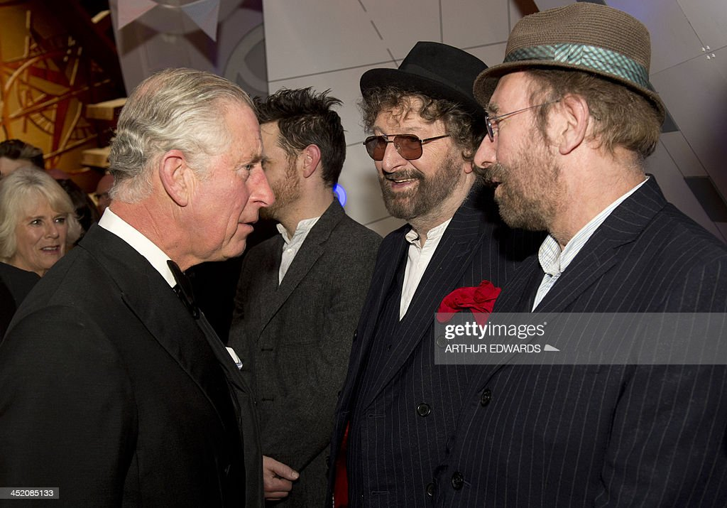Britain's Prince Charles, Prince of Wales (L) greets British musicians Chas and Dave (R) as he attends the Royal Variety Performance at the London Palladium Theatre on November 25, 2013. The Royal Variety Performance takes place annually in aid of the Entertainment Artistes Benevolent Fund (EABF) which cares for hundreds of entertainers throughout the UK who need help and assistance as a result of old age, ill-health or hard times.