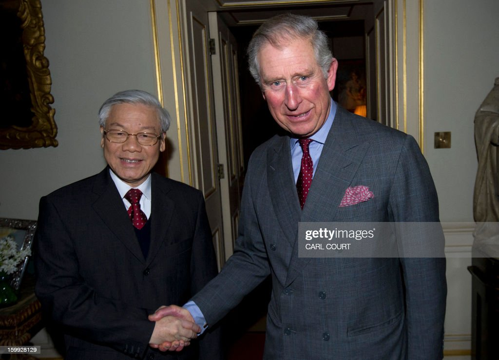 Britain's Prince Charles, Prince of Wales (R), greets Vietnamese General Secretary of the Communist Party Nguyen Phu Trong (L) at Clarence House in central London on January 23, 2013. Trong arrived in London on January 22 for a two-day visit that marked 40 years of diplomatic relations between the UK and Vietnam.