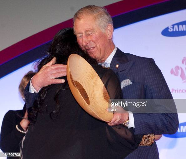 Britain's Prince Charles Prince of Wales hugs Afsana Benozir from Tower Hamlets who received the Samsung Young Achievers award at the Prince's Trust...
