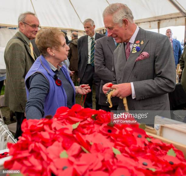 Britain's Prince Charles Prince of Wales is presented with a handmade poppy on a visit to the Westmorland County Show in Milnthorpe northern England...