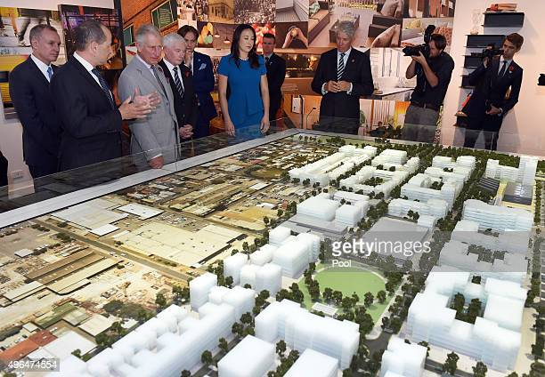Britain's Prince Charles Prince of Wales is shown a scale model of the Bowden precinct during a visit to the sustainable urban development on...