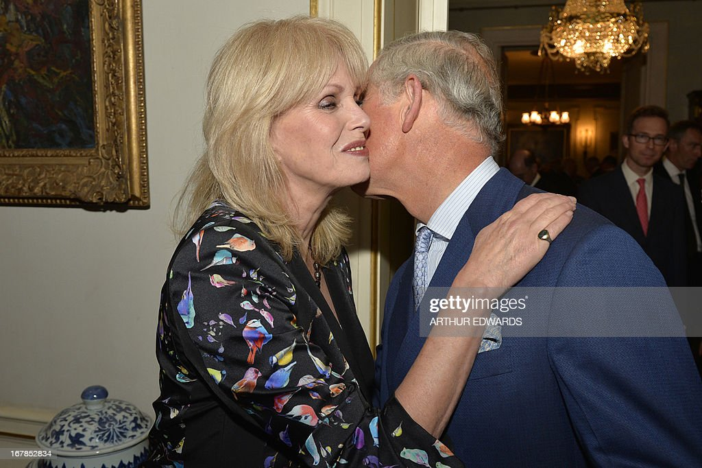 Britain's Prince Charles, Prince of Wales (R), kisses British actress Joanna Lumley (L) during a reception for supporters to mark the 60th anniversary of the charity 'Samaritans' at Clarence House in central London on May 1, 2013. Samaritans was founded in 1953 by Dr Chad Varah. It was the world's first 24 hour telephone helpline and has expanded from one man and a phone, 60 years ago, to 20,665 volunteers, in 201 branches, answering more than five million calls for help. AFP PHOTO / POOL / ARTHUR EDWARDS