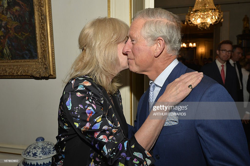 Britain's Prince Charles, Prince of Wales (R), kisses British actress Joanna Lumley (L) during a reception for supporters to mark the 60th anniversary of the charity 'Samaritans' at Clarence House in central London on May 1, 2013. Samaritans was founded in 1953 by Dr Chad Varah. It was the world's first 24 hour telephone helpline and has expanded from one man and a phone, 60 years ago, to 20,665 volunteers, in 201 branches, answering more than five million calls for help.