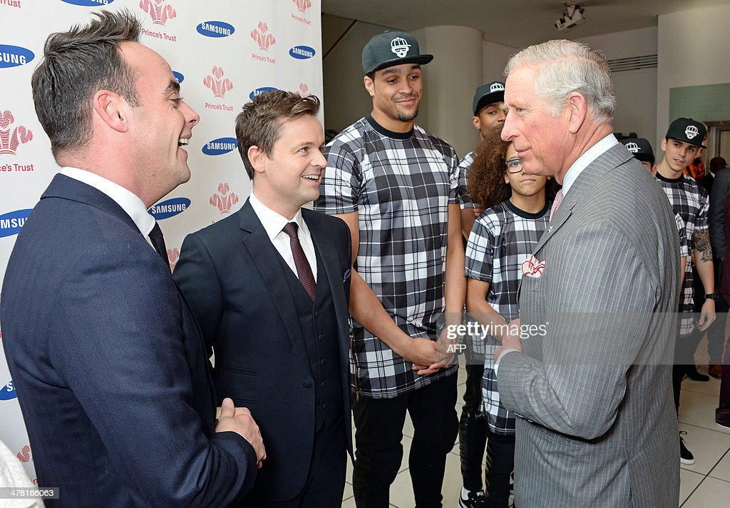 Britain's Prince Charles, Prince of Wales (R), meets (L to R) Anthony McPartlin, Declan Donnelly, Ashley Banjo and Perri Kiely during the Prince's Trust & Samsung Celebrate Success Awards at Odeon Leicester Square in Central London on March 12, 2014. AFP PHOTO/POOL/DAVID M. BENETT