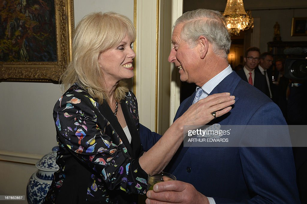 Britain's Prince Charles, Prince of Wales (R), meets British actress Joanna Lumley (L) during a reception for supporters to mark the 60th anniversary of the charity 'Samaritans' at Clarence House in central London on May 1, 2013. Samaritans was founded in 1953 by Dr Chad Varah. It was the world's first 24 hour telephone helpline and has expanded from one man and a phone, 60 years ago, to 20,665 volunteers, in 201 branches, answering more than five million calls for help.