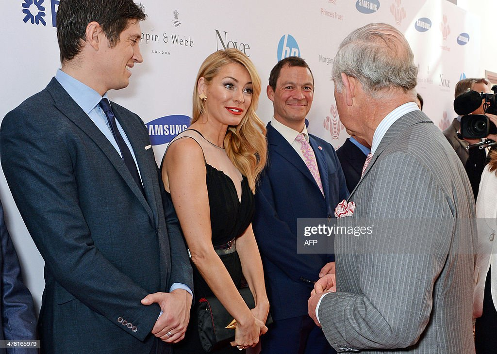 Britain's Prince Charles, Prince of Wales (R), meets (L to R) English tv presenter Vernon Kay, English model and presenter Tess Daly and English actor Dominic West during the Prince's Trust & Samsung Celebrate Success Awards at Odeon Leicester Square in Central London on March 12, 2014.