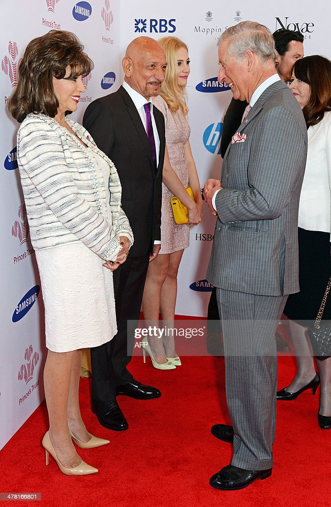 Britain's Prince Charles, Prince of Wales (R), meets (L to R) Joan Collins, Sir Ben Kingsley, Pixie Lott and Luke Evans during the Prince's Trust & Samsung Celebrate Success Awards at Odeon Leicester Square in Central London on March 12, 2014.
