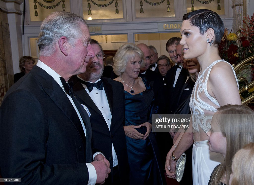 Britain's Prince Charles, Prince of Wales (L) meets with British pop artist Jessie J (R) as he and Camilla, Duchess of Cornwall (C) attend the Royal Variety Performance at the London Palladium Theatre on November 25, 2013. The Royal Variety Performance takes place annually in aid of the Entertainment Artistes Benevolent Fund (EABF) which cares for hundreds of entertainers throughout the UK who need help and assistance as a result of old age, ill-health or hard times.