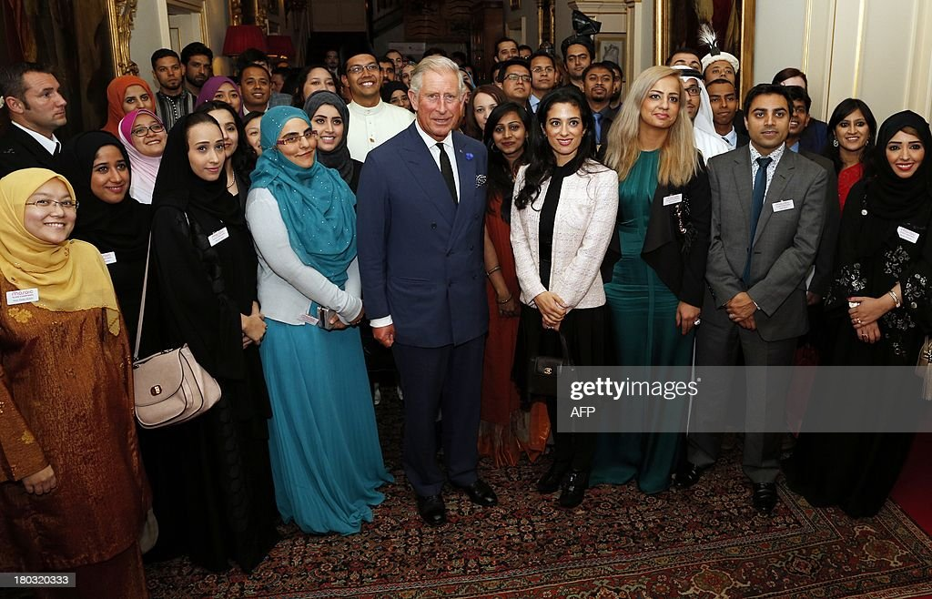 Britain's Prince Charles, Prince of Wales, president and founder of Mosaic (CL), hosts a reception for participants in the Mosaic Leadership Programme alongside Jordan's Princess Badiya bint el-Hassan (CR) at Clarence House in central London on September 11, 2013. The Mosaic Leadership Programme aims to develop leadership ability, an understanding of key global issues and to equip delegates to become active and positive leaders in their local community.