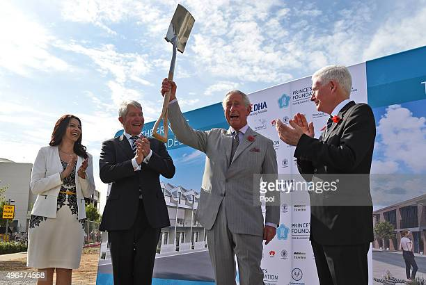 Britain's Prince Charles Prince of Wales raises the spade after turning the first sod during a visit to the Bowden precinct a sustainable urban...