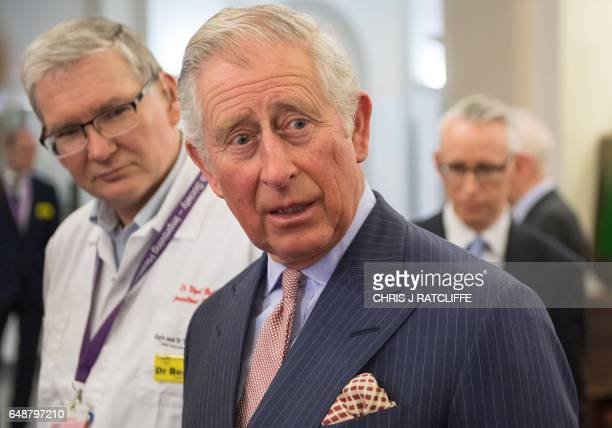 Britain's Prince Charles Prince of Wales reacts during his visit to St Thomas's Hospital in London on March 6 2017 The Prince in his role as Patron...