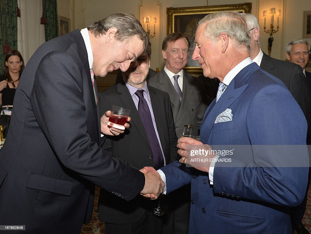 Britain's Prince Charles, Prince of Wales (R) shakes hands with British actor Stephen Fry (L) during a reception for supporters to mark the 60th anniversary of the charity 'Samaritans' at Clarence House in central London on May 1, 2013. Samaritans was founded in 1953 by Dr Chad Varah. It was the world's first 24 hour telephone helpline and has expanded from one man and a phone, 60 years ago, to 20,665 volunteers, in 201 branches, answering more than five million calls for help.