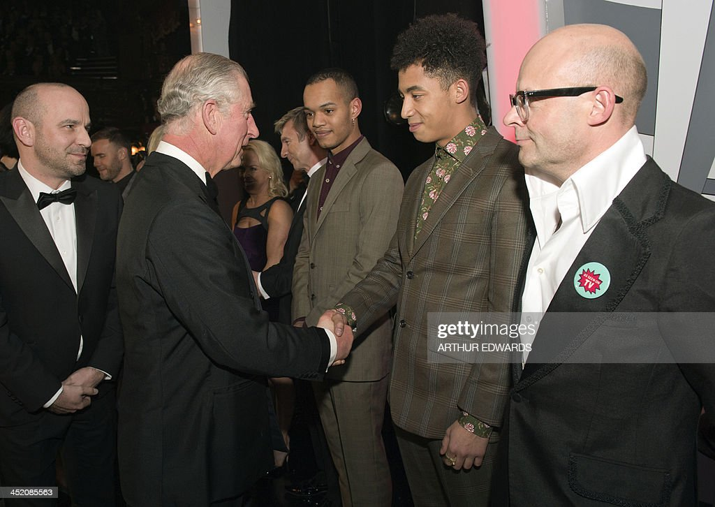 Britain's Prince Charles, Prince of Wales (L) shakes hands with Jordan Stephens (2R) of British hip hop band Rizzle Kicks as the other half of the duo Harley Alexander-Sule (3R) and British comedian Harry Hill (R) wait during the Royal Variety Performance at the London Palladium Theatre on November 25, 2013. The Royal Variety Performance takes place annually in aid of the Entertainment Artistes Benevolent Fund (EABF) which cares for hundreds of entertainers throughout the UK who need help and assistance as a result of old age, ill-health or hard times. AFP PHOTO / POOL / ARTHUR EDWARDS