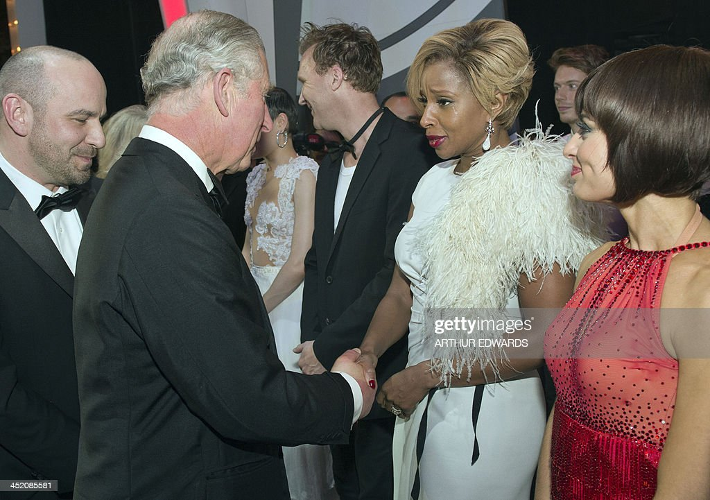 Britain's Prince Charles, Prince of Wales (L) shakes hands with US singer-songwriter Mary J Blige (R) during the Royal Variety Performance at the London Palladium Theatre on November 25, 2013. The Royal Variety Performance takes place annually in aid of the Entertainment Artistes Benevolent Fund (EABF) which cares for hundreds of entertainers throughout the UK who need help and assistance as a result of old age, ill-health or hard times.