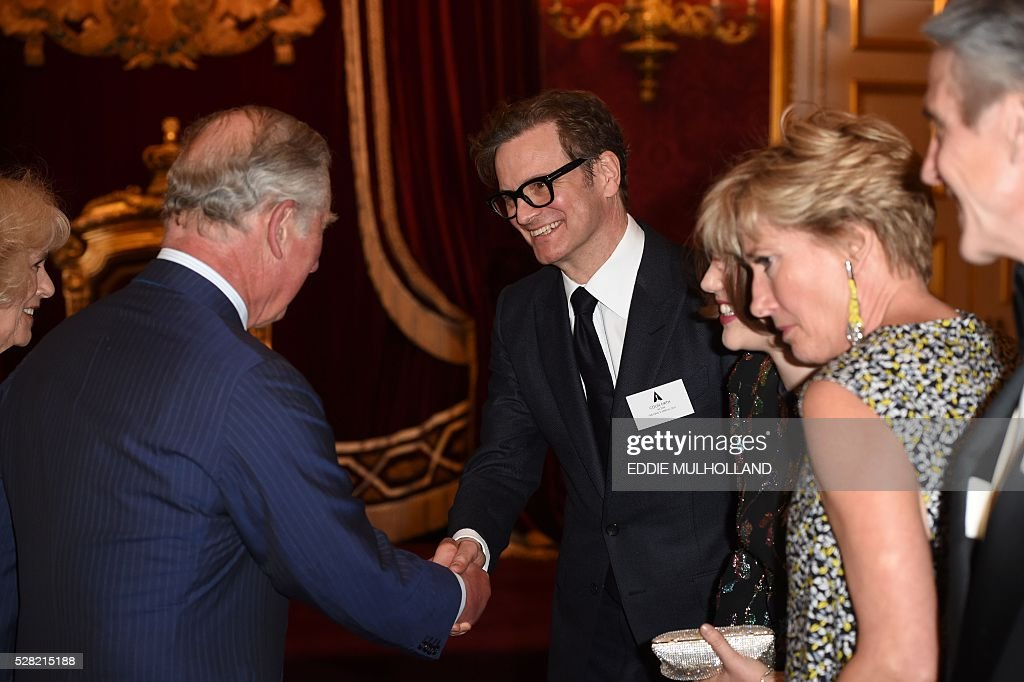 Britain's Prince Charles, Prince of Wales speaks with actor Colin Firth (3rd R) at a reception for British Oscar Winners in central London on May 4, 2016. The Oscars represent excellence in filmmaking and it is a testament to the talent in the United Kingdom that more than��300��British artists and filmmakers have earned this��honour. / AFP / POOL / Eddie Mulholland