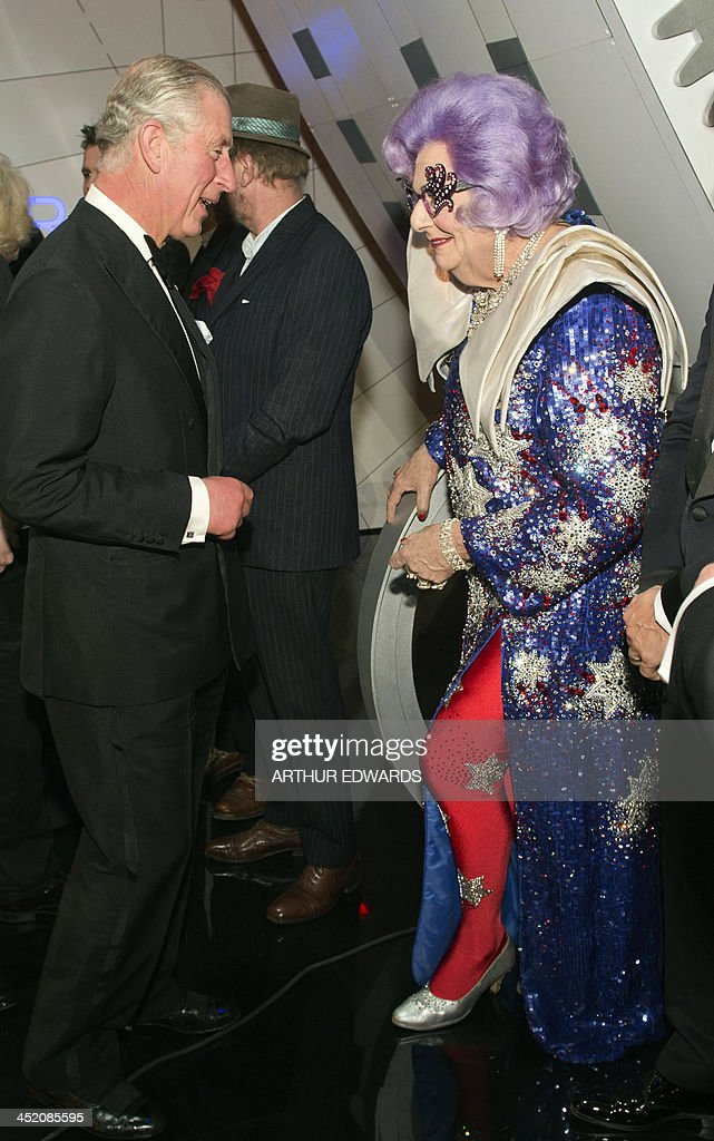 Britain's Prince Charles, Prince of Wales (L) speaks with Australian comedian Barry Humphries in his alter ego as Dame Edna Everage (R) during the Royal Variety Performance at the London Palladium Theatre on November 25, 2013. The Royal Variety Performance takes place annually in aid of the Entertainment Artistes Benevolent Fund (EABF) which cares for hundreds of entertainers throughout the UK who need help and assistance as a result of old age, ill-health or hard times.
