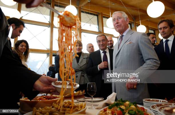 Britain's Prince Charles Prince of Wales tastes Amatriciana pasta dish during a visit to the Italian quakehit town of Amatrice on April 2 2017 as...