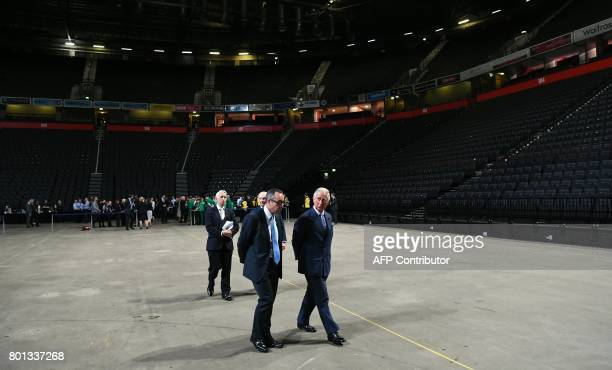 Britain's Prince Charles Prince of Wales tours the Manchester Arena in Manchester north west England on June 26 after meeting with staff who helped...